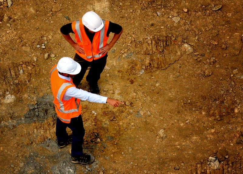 Aerial view of two workers at a job site