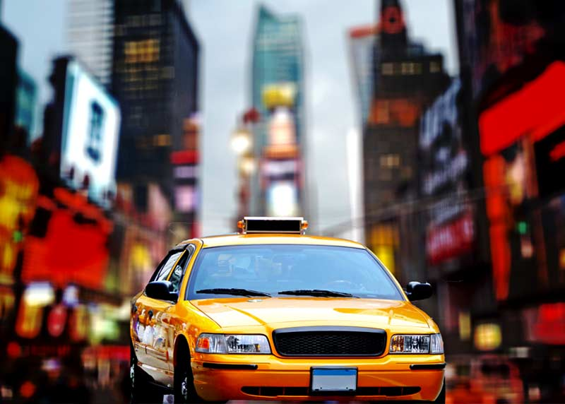 Yellow cab in a city