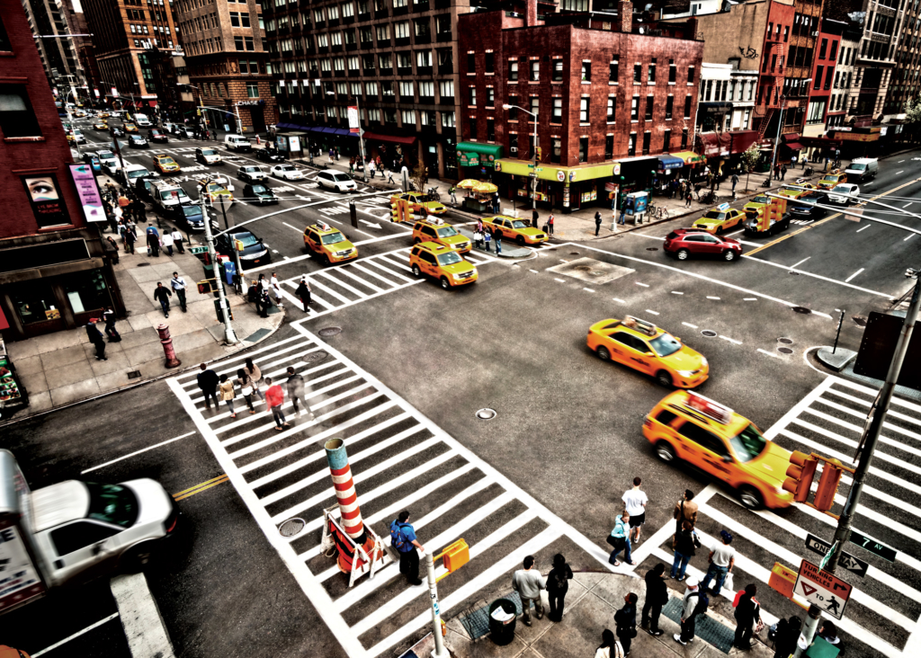 busy intersection with taxis